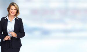 Senior business woman portrait over blue background.